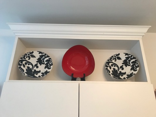 Plates and candy dish over my bathroom cabinet