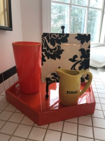 Plate and small pitcher next to the Jacuzzi in the bathroom
