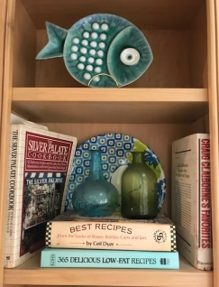 Two decorative plates in my kitchen bookcase