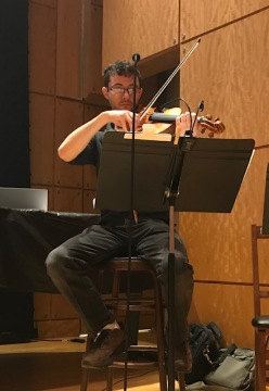 Violinist rehearsing at the venue
