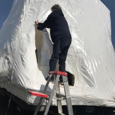 Tom cutting off the shrink wrap