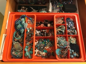 A large drawer of everyday jewelry, mostly earrings