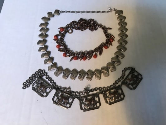 I have worn all of these necklaces, and I wore the center one often, for many years.