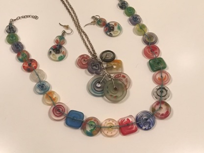 Button jewelry of resin