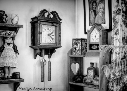 The wall chimer and the mantel clock and one antique doll (and more)